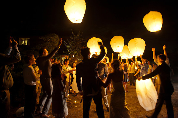 Floating lanterns at a wedding